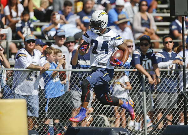San Diego Chargers running back Ryan Mathews hurdles obst...