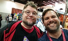 Phillip Lorenzo takes a selfie with director Guillermo del Toro at Comic-Con,...