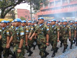 Guatemalan soldiers march in a parade through the country's capital, Guatemala City. June 30, 2006.