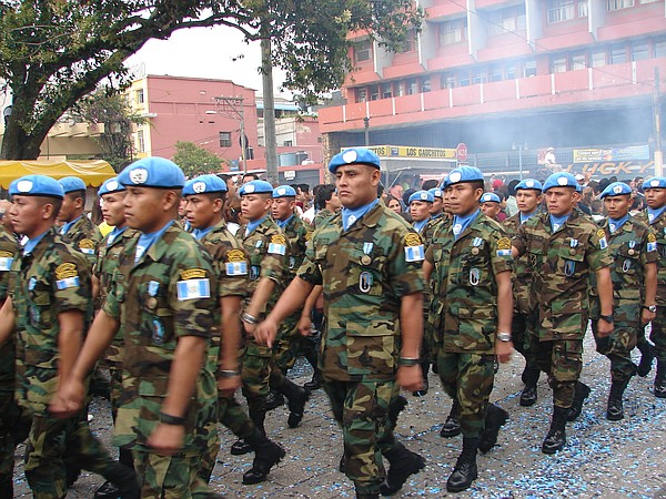 Guatemalan soldiers march in a parade through the country's capital, Guatemal...