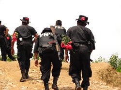 Guatemalan national police on a mission to eradicate poppy cultivation in the country's northern highlands. Sept. 1, 2006.