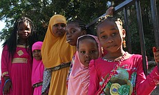 "Members of the Somali Bantu community in City Heights join together on July 28, 2014, for Eid al-Fitr festivities. Eid al-Fitr, translating to ""the feast to break the fast,"" marks the finale of Ramadan, the Islamic holy month during which Muslims fast and pray to reach a higher spiritual state."