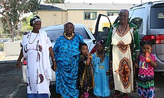 "Near 50th Street in City Heights, Somali Bantu women and children celebrate Eid al-Fitr and dance to cultural folk music playing from their car, July 28, 2014. During Eid, Somali Bantu women wear traditional African dresses. In their native tongue, Kizigua, the women call these dresses ""bati"" or ""sethe."""