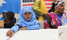 A young Muslim girl learns about the tradition of Eid al-Fitr at the Somali Bantu Association of America office in City Heights, July 28, 2014.