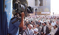 Cameraman Karel Bauer at a prayer service.