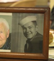 "A photo shows Verlin ""Buzz"" Fortin at age 89 and at age 18, when he served aboard the USS Indianapolis."