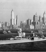 The USS Indianapolis sails by New York Harbor before 1945.