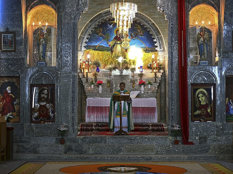 Friar Gabriel Tooma leads Mass at the Chaldean Church of the Virgin Mary of t...