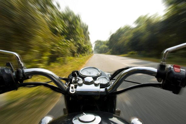 A motorcycle speeds along a country road, Nov. 22, 2009.