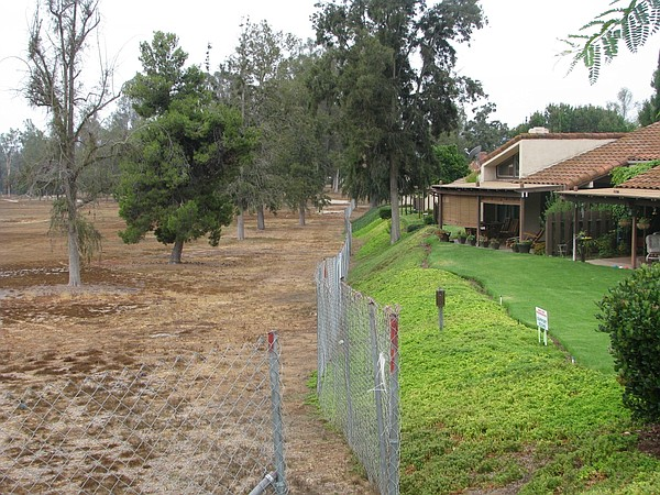 The unwatered Escondido Country Club Golf Course sits nex...