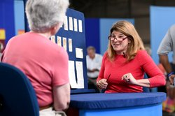 """Leila Dunbar appraises a collection of early Boston baseball memorabilia for the program """"Antiques Roadshow"""" in New York, Aug. 9, 2014."""