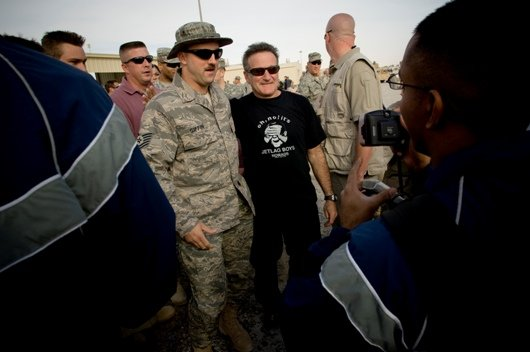 Robin Williams takes a picture with the troops in Kuwait, 2007.