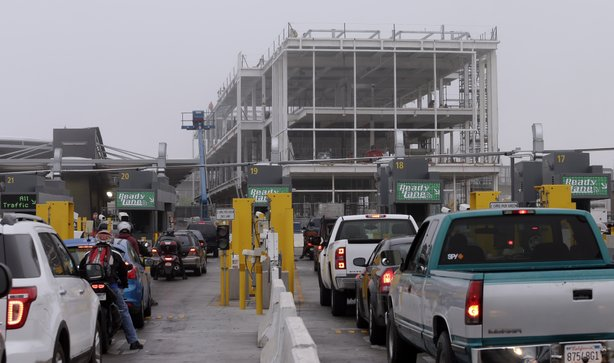 Cars wait in lines to cross at the San Ysidro Port of Entry, June 27, 2013.