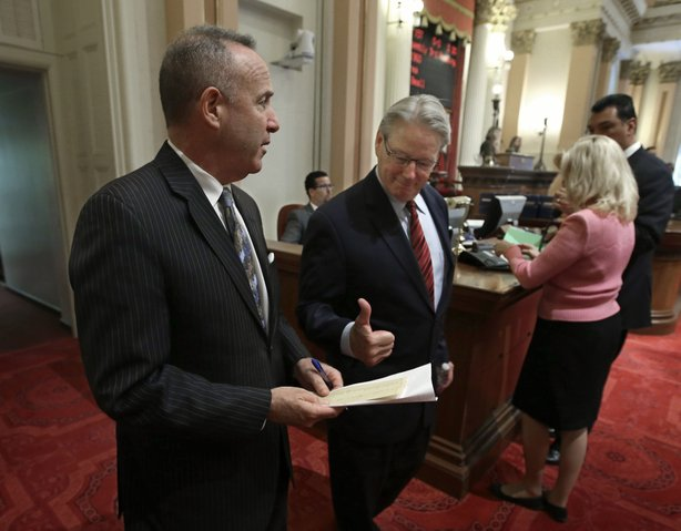 California Sen. William Monning, D-Carmel, gives Senate President Pro Tem Darrell Steinberg, D-Sacramento, left, a thumbs up to show his support for a proposed water bond measure at the Capitol, Aug. 13, 2014.