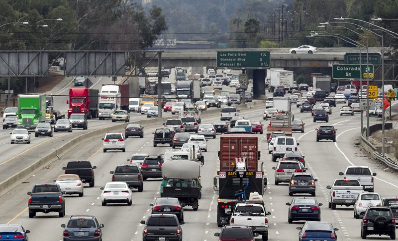 Late morning traffic travels on Interstate 5, in Los Angeles, Feb. 6, 2014.