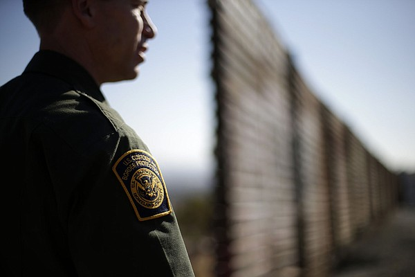 A Border Patrol agent guards the Mexico-California border...