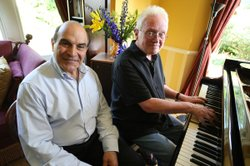 David Suchet sits at the piano with Christopher Gunning, British composer of ...