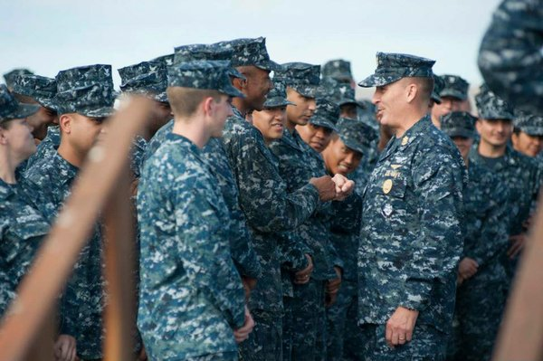 Master Chief Petty Officer of the Navy Mike Stevens greets crew members aboar...