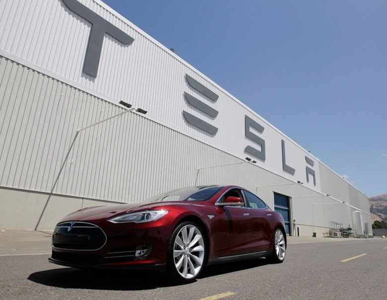 A Tesla automobile sits outside the California factory, in this undated photo.