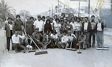 An early shot of members of Los Dukes de Tijuana after volunteering in a comm...
