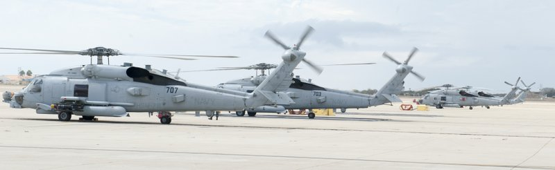 Detachments 1 and 2 of Helicopter Maritime Strike Squadron 78 land at Naval A...