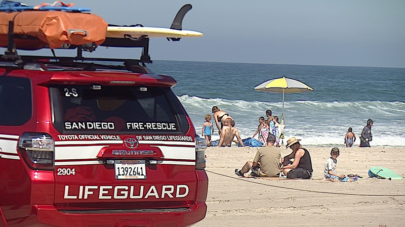 San Diego lifeguards monitor the beach at Tourmaline Surf Park in Pacific Bea...