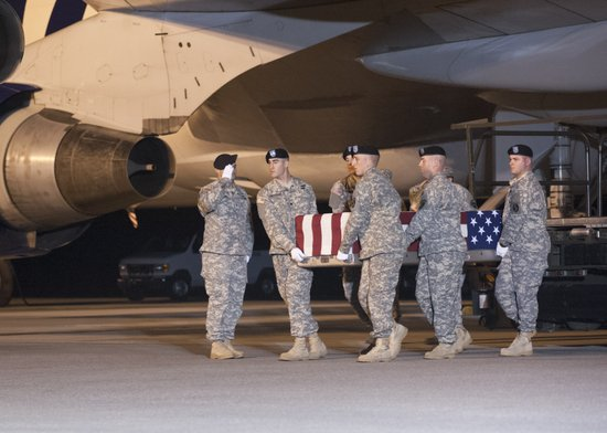 A U.S. Army carry team transfers the remains of Sgt. Christopher W. Mulalley ...