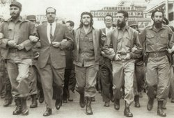 Fidel Castro (far left), Che Guevara (center), and other leading revolutionar...