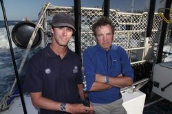 Dr. Charlie Huveneers and Mark Evans ready to tag a great white shark.
