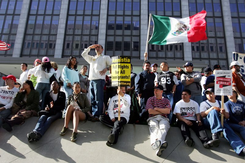 Protesters rally for immigration reform outside of the federal building in do...