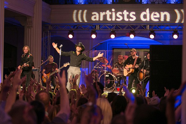Country superstar Tim McGraw tears through a dozen songs,...