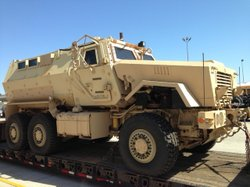 An image shows the MRAP was painted tan when it was first received by the San...