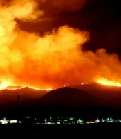 U.S. Marines and fire crews at Marine Corps Base Camp Pendleton battle wildfires at night, May 14, 2014.