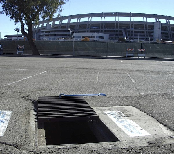 A grate inlet was tested in the Qualcomm Stadium parking ...