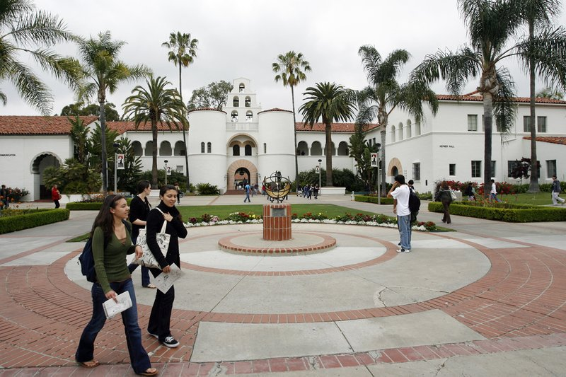 Students are shown walking on the campus of San Diego State University,  May ...