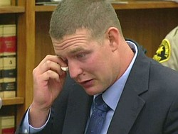 Ex-San Diego police Officer Christopher Hays wipes his eyes during his senten...