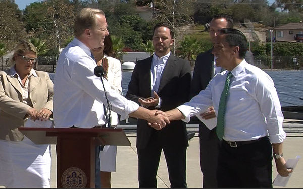 San Diego Mayor Kevin Faulconer shakes the hand of Council President Todd Glo...