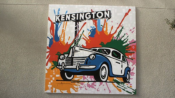 An 8'x8' mural portraying a vintage car and the Kensingto...