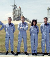 Judith Resnik posing in front of launch with crew.