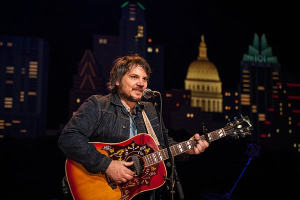 Jeff Tweedy and his son Spencer and members of the band L...