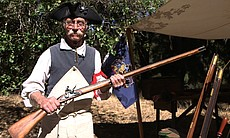 "Rick ""Richabod"" Emms holds one of his handmade guns at the Laguna Mountain Rendezvous 20 miles north of Julian on October 24, 2014."