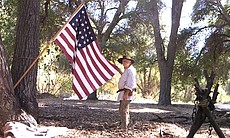 "Lon ""Weasel Breath"" Atkinson shows off his wife's handmade 24-star 1800s era flag at the Laguna Mountain Rendezvous 20 miles north of Julian on October 24, 2014."