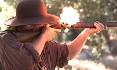 "Pat ""Thunder McMichael shoots a reproduction of an 1800s flint-lock rifle at the Laguna Mountain Rendezvous 20 miles north of Julian on October 24, 2014."
