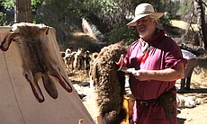"Mike ""Hatman"" Robinson shows off his handmade Buffalo headdress for sale at the Laguna Mountain Rendezvous 20 miles north of Julian on October 24, 2014."
