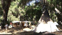 Campers sleep in authentic period shelters like this teepee with 26-foot-tall...