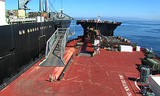 The USNS Montford Point (right) is connected vi...