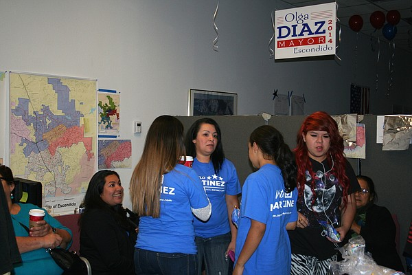 District 1 candidate Consuelo Martinez (left, in black) and supporters wait f...