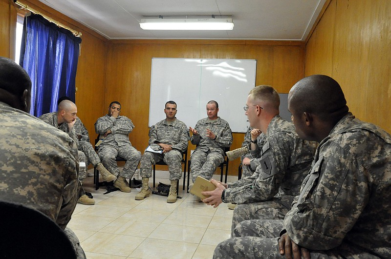 Capt. Ray Mooneyham leads a small group in suicide intervention training at C...