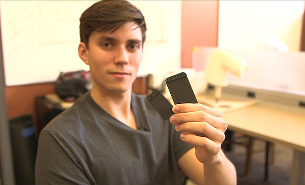 SDSU engineering student Spencer Koroly holds up rectangular plastic parts of...