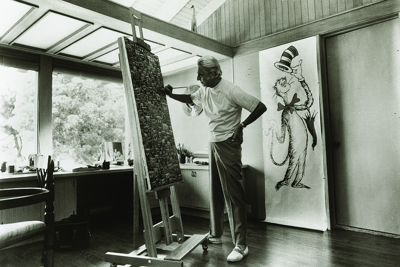Theodor Geisel aka Dr. Seuss at his easel.